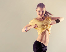 Aerobics fitness workout. Young athletic female dancing street dance in studio.  Concept of sport and health.